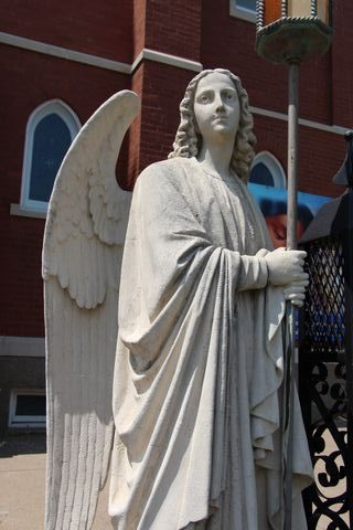 Angel in front of the Catholic church in Glasgow, Missouri
