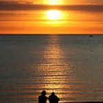 couple at sunset on Lake Michigan near Charlevoix, Michigan