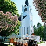horse-drawn carriage passing by St. Ann's church, Mackinac Island, MI