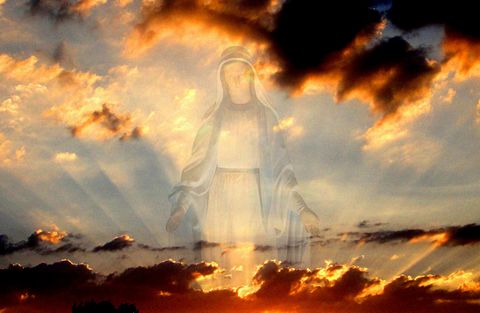 Virgin Mary image in the clouds at sunset