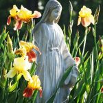 Statue of Blessed Mary with flowers