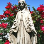 Statue of Mary with roses