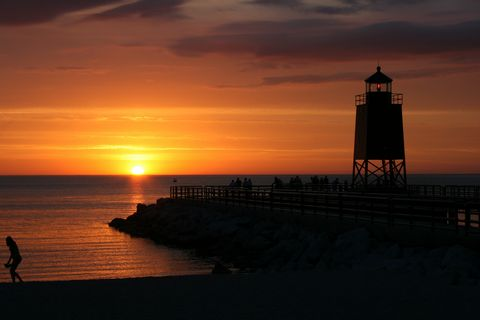Sunset & lighthouse at Charlevoix, Michigan