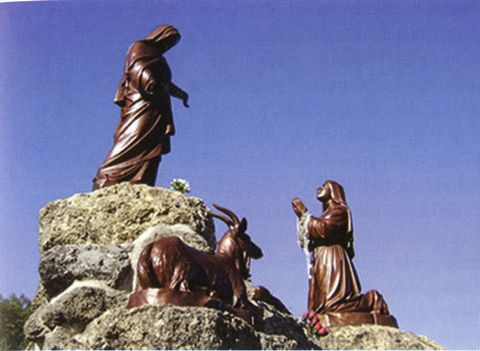 Statues located at the Laus apparition site commemorate the apparitions.
