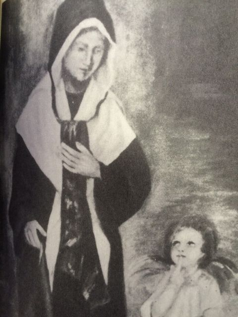 "Catherine is led by a ""glowing child-angel"" to meet the Virgin Mary in 1830."
