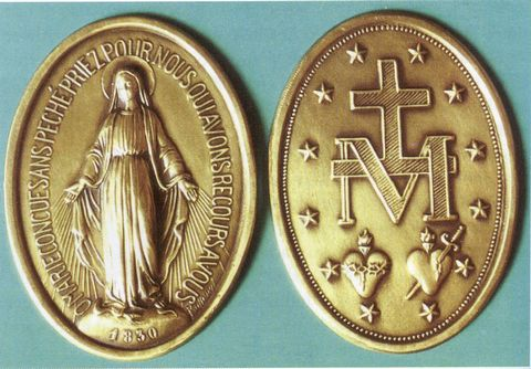 The actual Miraculous Medal as designed precisely by the Virgin Mary.