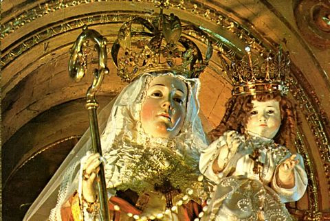 The painted wooden statue of Mary and Jesus, completed by the archangels.