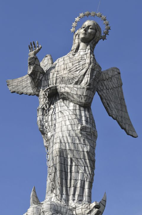 The large statue high above the church in Quito, Ecuador.