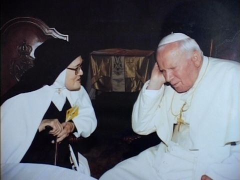 Pope John Paul II meets Lucia in 2000; Luminous Mysteries in 2002.