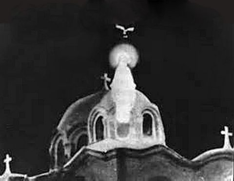 A clearly recognizable Virgin Mary materializes above the church
