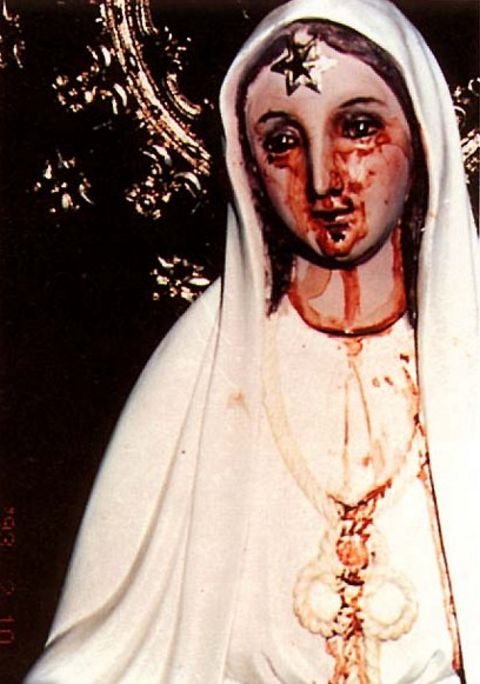 The weeping blood of the Virgin's statue in Agoo. The observing bishop placed his fingers in it.