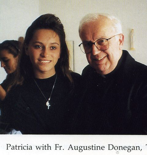 Patricia with a priest