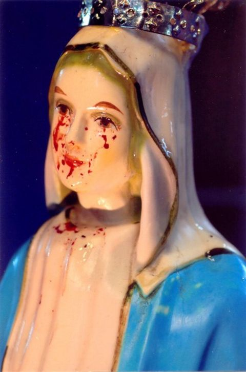Julia's statue of Mary, Mother of Mercy begins shedding tears and blood.